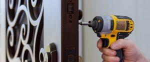 New house hand close-up builder in installing a door lock the door of close-up.