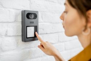 Woman rings the house intercom